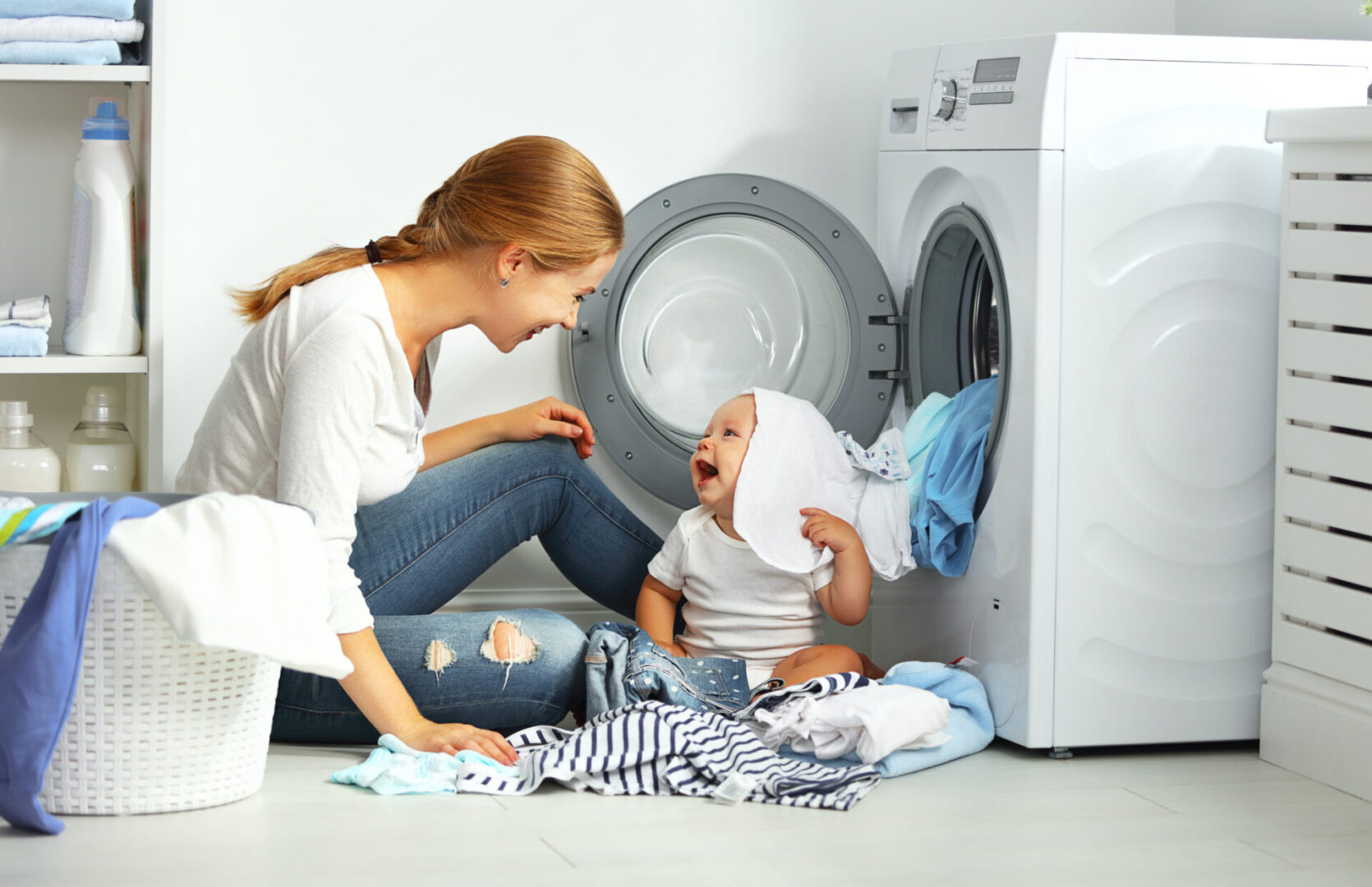 Mother,A,Housewife,With,A,Baby,Engaged,In,Laundry,Fold